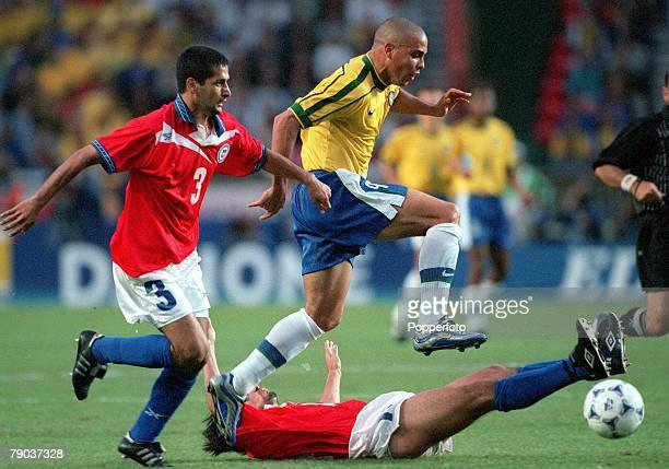 World Cup Finals 2nd Round Paris France 27th June Brazil 4 v Chile 1 Brazil's Ronaldo with Chile's Miguel Ramirez Ronaldo Fuentes