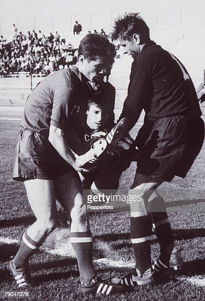World Cup Finals Arica Chile 31st May Soviet Union 2 v Yugoslavia 0 Soviet Unions rightback Dubinsky is carried away after fracturing his leg