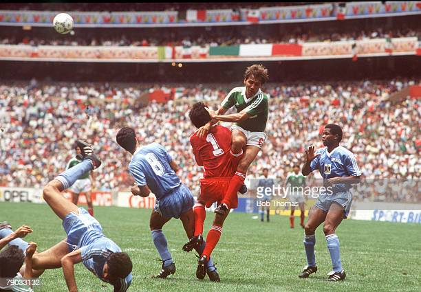 World Cup Finals Azteca Stadium Mexico 11th June Mexico 1 v Iraq 0 Mexico's Carlos De Los Cobos challenges Iraq's goalkeeper Raad as Amaiesh moves...