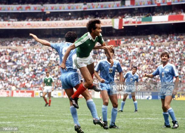 World Cup Finals Azteca Stadium Mexico 11th June Mexico 1 v Iraq 0 Mexico's Fernando Quirarte leaps high with Iraq's Mahmoud