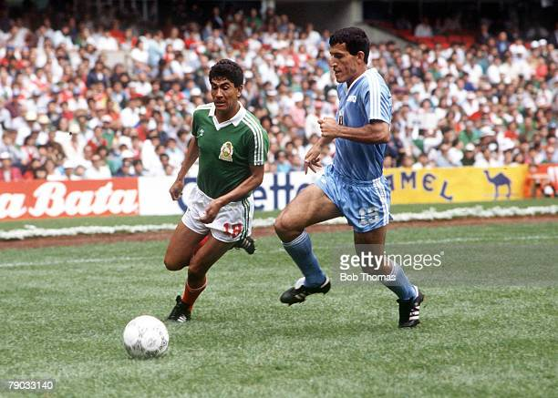 World Cup Finals Azteca Stadium Mexico 11th June Mexico 1 v Iraq 0 Mexico's Rafael Flores is chased for the ball by Iraq's Kassim