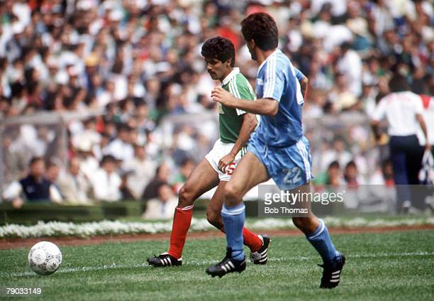 World Cup Finals Azteca Stadium Mexico 11th June Mexico 1 v Iraq 0 Mexico's Luis Flores and Iraq's Al Roubai chase the ball