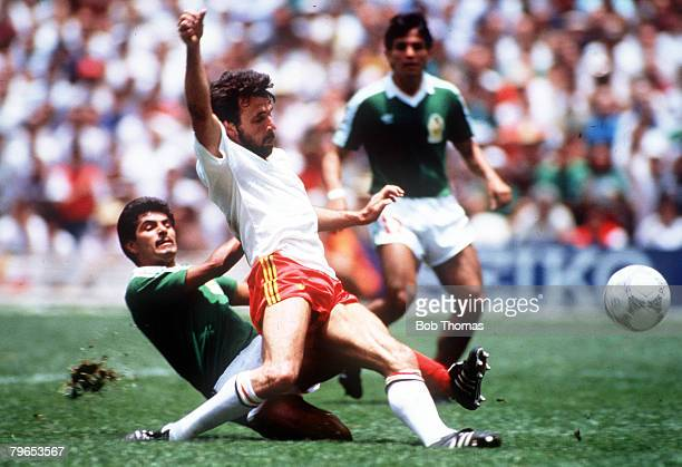 World Cup Finals, Azteca Stadium, Mexico, 3rd June Mexico 2 v Belgium 1, Mexico's Luis Flores moves in to challenge Belgium's Eric Gerets for the ball