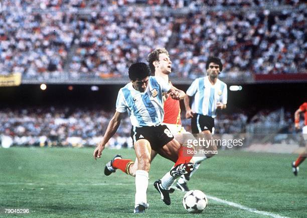 World Cup Finals Barcelona Spain 13th June Argentina 0 v Belgium 1 Argentina's Luis Galvan forces Belgium's Guy Van Der Smissen off the ball