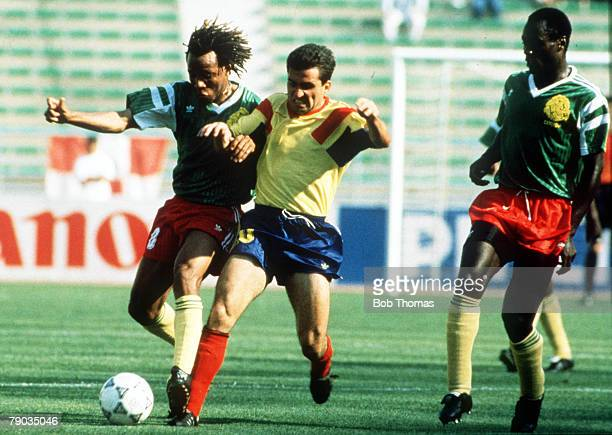 World Cup Finals Bari Italy 14th June Cameroon 2 v Romania 1 Cameroon's Cyrille Makanaky battles for the ball with Romania's Gheorghe Hagi