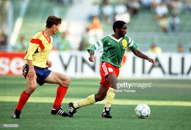 World Cup Finals Bari Italy 14th June Cameroon 2 v Romania 1 Cameroon's Mbouh Mbouh moves past Romania's Ioan Sabau with the ball