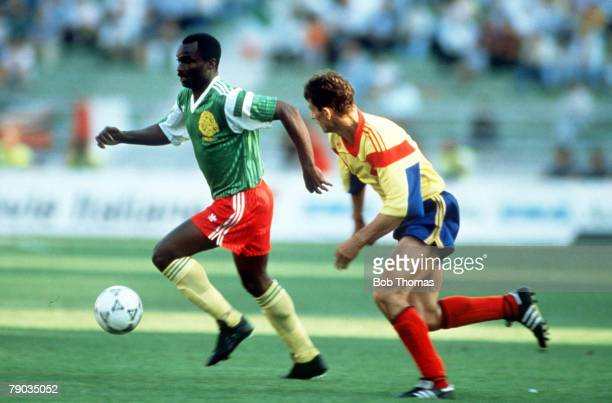 World Cup Finals Bari Italy 14th June Cameroon 2 v Romania 1 Cameroon's Roger Milla moves away from Romania's Ioan Sabau with the ball