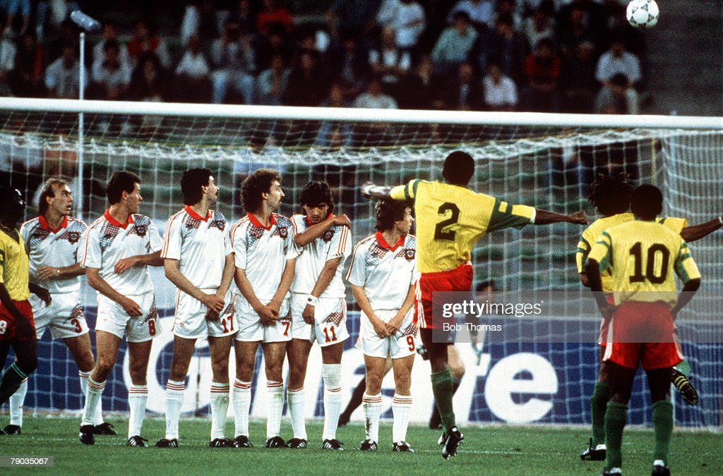 1990 World Cup Finals. Bari, Italy. 18th June, 1990. USSR 4 v Cameroon 0. Cameroon's Andre Kana Biyick takes a free kick which beats the Soviet wall but flies over the cross bar. : News Photo