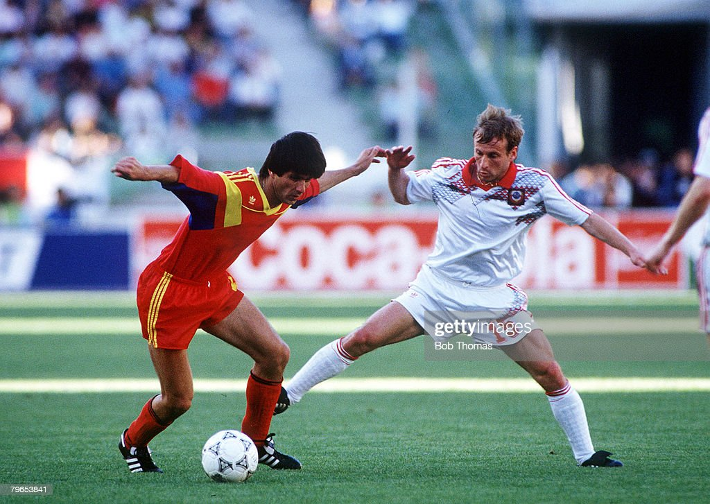 1990 World Cup Finals, Bari, Italy, 9th June, 1990, Romania 2 v USSR 0, Romania's Marius Lacatus is challenged for the ball by USSR's Ivan Yaremchuk : News Photo