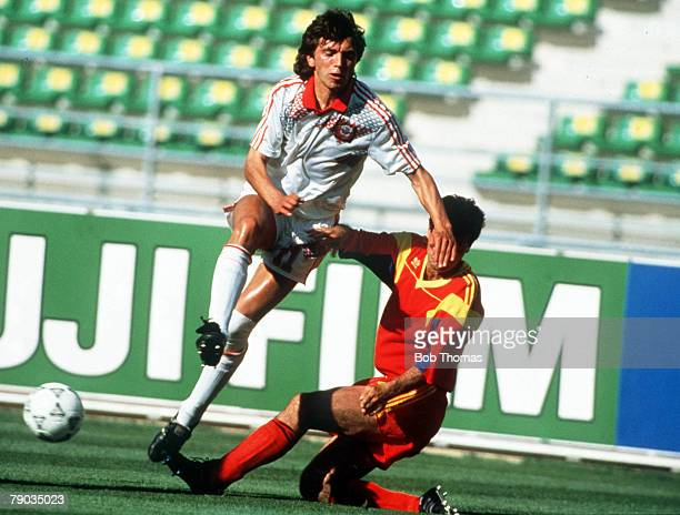 World Cup Finals Bari Italy 9th June Romania 2 v USSR 0 USSR's Igor Dobrovolski is challenged for the ball by Romania's Mircea Rednic