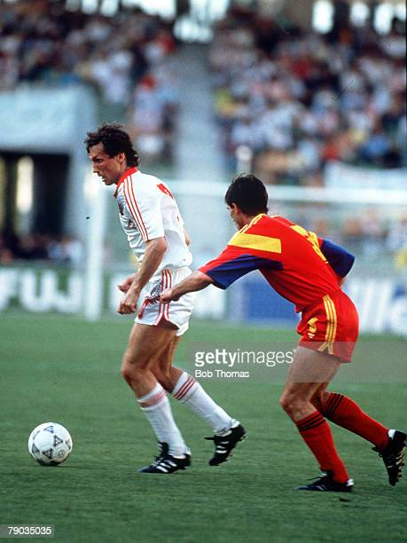 World Cup Finals Bari Italy 9th June Romania 2 v USSR 0 USSR's Oleg Protasov moves away from Romania's Michael Klein with the ball
