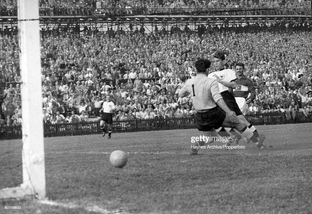 World Cup Finals, 1954 Berne, Switzerland. 17th June,1954. Germany 4 v Turkey 1. The Turkish goalkeeper Turgay is beaten by German forward Hans Shafer during their Group Two match. : News Photo