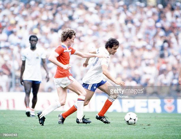 World Cup Finals Bilbao Spain 16th June England 3 v France 1 France's Michel Platini is challenged by England's Graham Rix