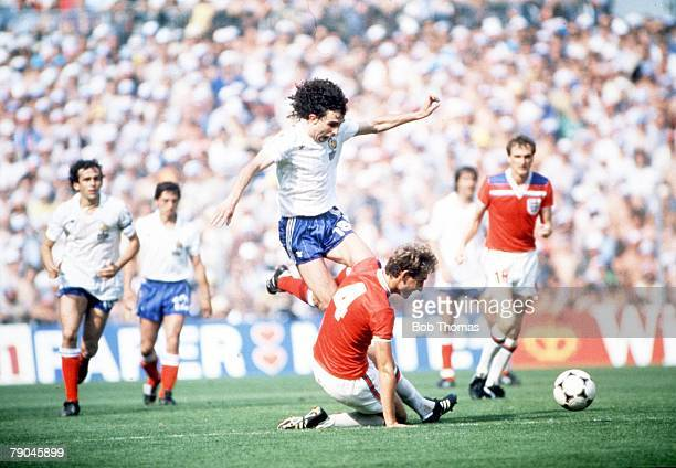 World Cup Finals Bilbao Spain 16th June England 3 v France 1 France's Dominique Rocheteau leaps over England's Terry Butcher