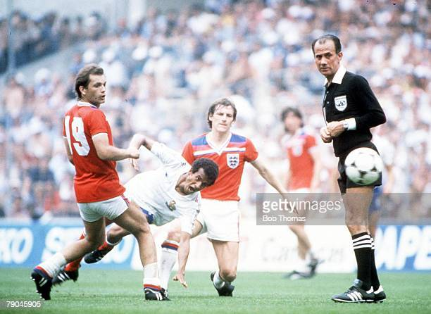 World Cup Finals Bilbao Spain 16th June England 3 v France 1 France's Jean Tigana falls under challenge from England's Steve Coppell and Ray Wilkins
