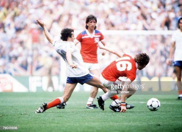 World Cup Finals Bilbao Spain 16th June England 3 v France 1 France's Michel Platini goes in to tackle with England's Bryan Robson