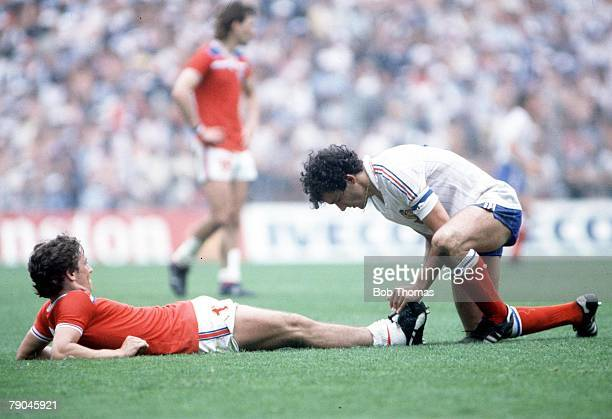 World Cup Finals Bilbao Spain 16th June England 3 v France 1 French star Michel Platini gives assistance to England's injured Kenny Sansom