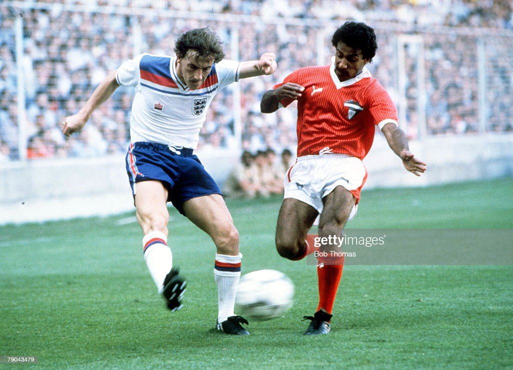 1982 World Cup Finals. Bilbao, Spain. 25th June, 1982. England 1 v Kuwait 0. England's Steve Coppell crosses the ball past Kuwait's Waleed Jasem : News Photo