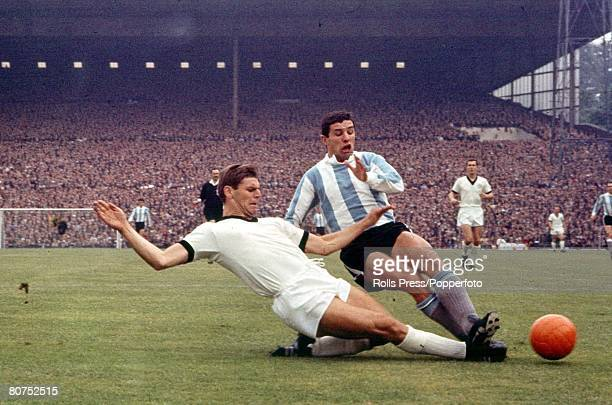 World Cup Finals Birmingham England 16th July Argentina 0 v West Germany 0 West Germany's Wolfgang Weber and Argentine Jorge Solari both go for the...
