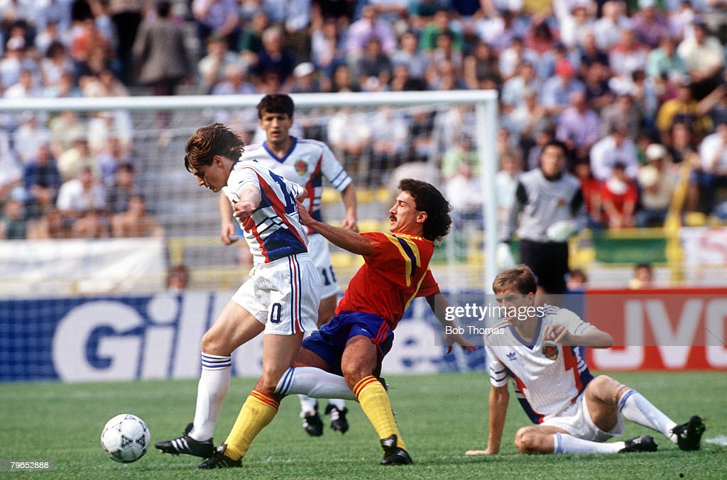 1990 World Cup Finals, Bologna, Italy, 14th June, 1990, Yugoslavia 1 v Colombia 0, Colombia's Gabriel Gomez is beaten to the ball by Yugoslavia's Dragan Stojkovic : News Photo