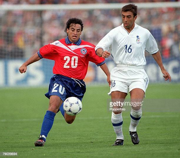 World Cup Finals Bordeaux France 11th JUNE 1998 Italy 2 v Chile 2 Italy's Roberto Di Matteo with Chile's Fabian Estay