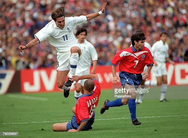 World Cup Finals Bordeaux France 11th JUNE 1998 Italy 2 v Chile 2 Italy's Dino Baggio hurdles over Chile's Javier Margas