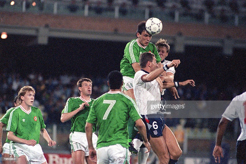 1990 World Cup Finals, Cagliari, Italy, 11th June, 1990, England 1 v Republic Of Ireland 1, Republic of Ireland's Tony Cascarino wins the ball in the air ahead of England's Stuart Pearce and Terry Butcher : News Photo