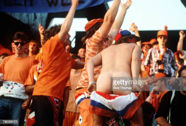 World Cup Finals Cagliari Italy 16th June England 0 v Holland 0 An over exuberant Dutch fan shows off his backside during the match