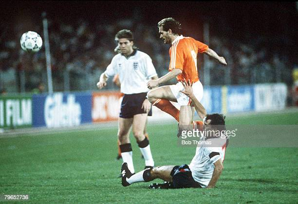 World Cup Finals Cagliari Italy 16th June England 0 v Holland 0 Holland's Jan Wouters hurdles the challenge of England's Bryan Robson