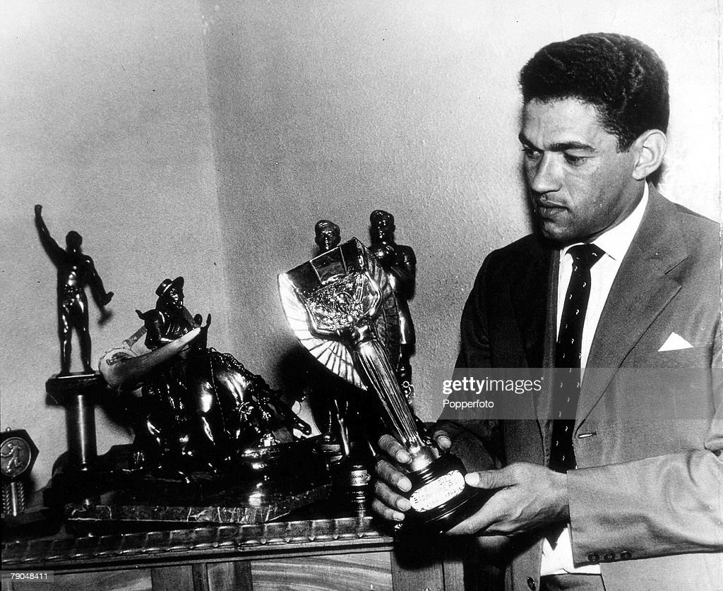 World Cup Finals, 1962, Chile. Brazil's Garrincha at home with his replica of the Jules Rimet trophy. : News Photo