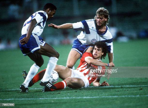 World Cup Finals, Florence, Italy, 19th June Austria 2 v USA 1, Austria's Anton Polster is challenged for the ball by USA's John Doyle and Desmond...