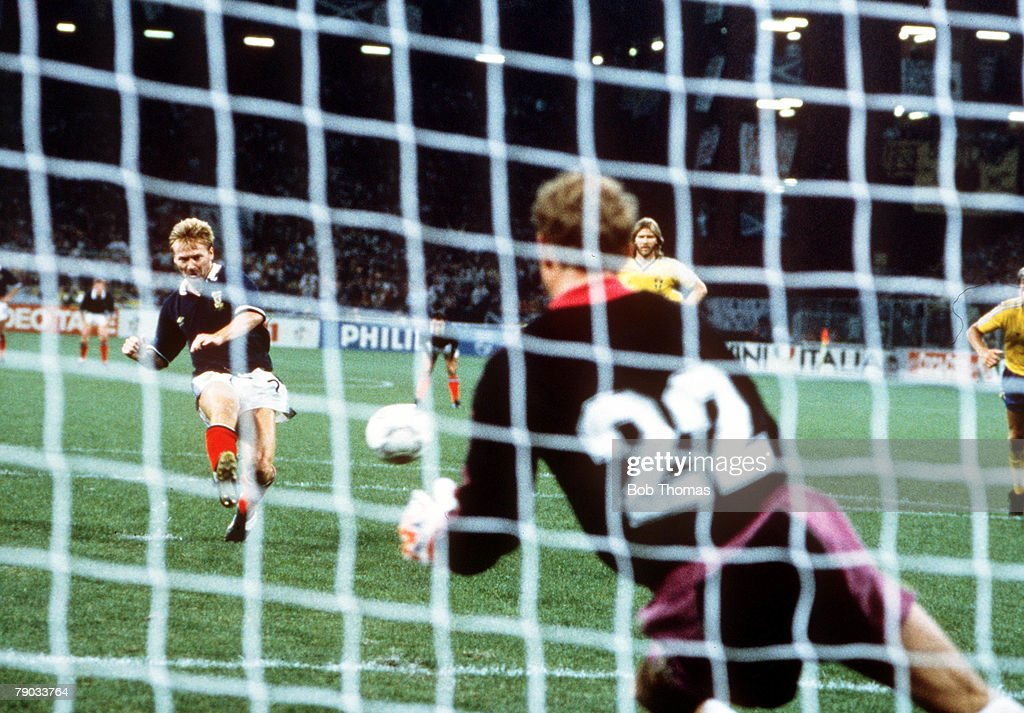 1990 World Cup Finals. Genoa, Italy. 16th June, 1990. Scotland 2 v Sweden 1. Scotland's Mo Johnston scores his goal from the penalty spot past Swedish goalkeeper Thomas Ravelli. : News Photo