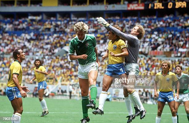 World Cup Finals Guadalajara Mexico 12th June Brazil 3 v Northern Ireland 0 Brazil's goalkeeper Carlos clears the ball with defender Edinho as...