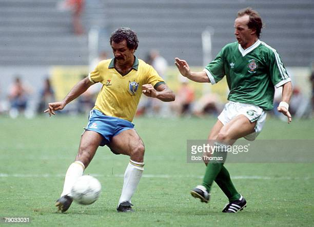 World Cup Finals Guadalajara Mexico 12th June Brazil 3 v Northern Ireland 0 Brazil's Junior is challenged for the ball by Northern Ireland's David...