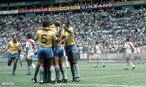World Cup Finals Guadalajara Mexico 14th June Brazil 4 v Peru 2 Brazilian forward Rivelino rushes over to join his teammates as they celebrate after...