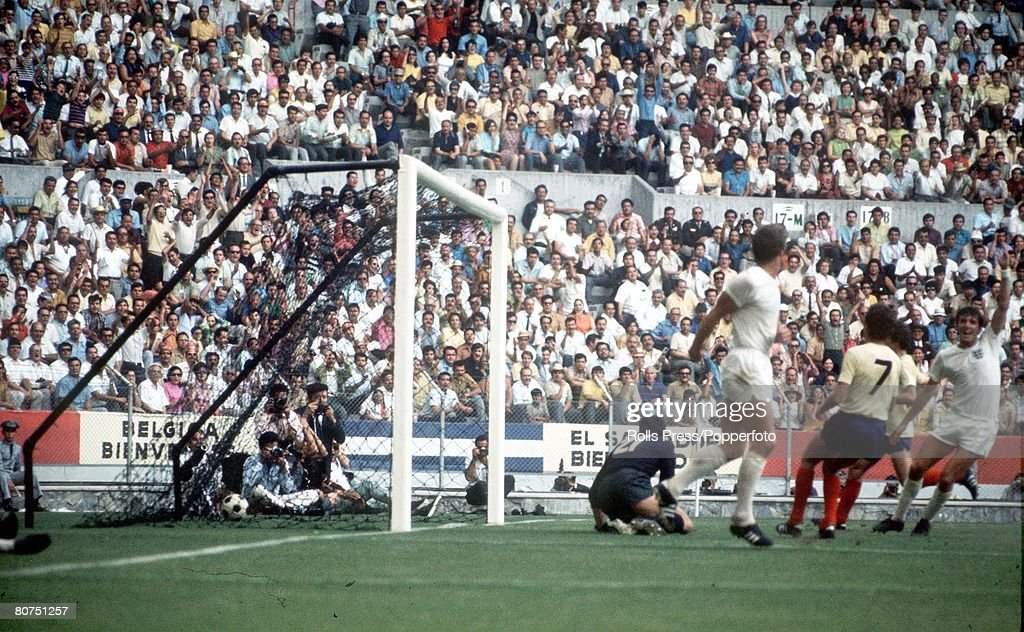 1970 World Cup Finals Guadalajara, Mexico. 2nd June, 1970. England 1 v Romania 0. Romanian goalkeeper Stere Adamche looks in the back of his goal after England striker Geoff Hurst (C) had scored the only goal in the two teams' opening Group match. : News Photo