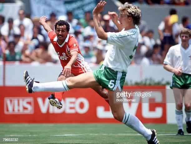 World Cup Finals Guadalajara Mexico 3rd June Algeria 1 v Northern Ireland 1 Algeria's Ben Marbrouk shoots past Northern Ireland's Alan McDonald