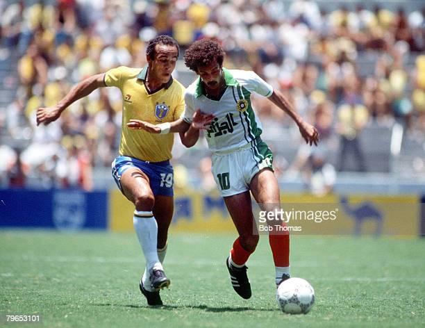 World Cup Finals Guadalajara Mexico 6th June Brazil 1 v Algeria 0 Algeria's Lakhdar Belloumi under strong pressure from Brazil's Elzo