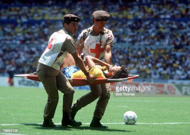 World Cup Finals Guadalajara Mexico 6th June Brazil 1 v Algeria 0 Brazil's Socrates is carried off on a stretcher