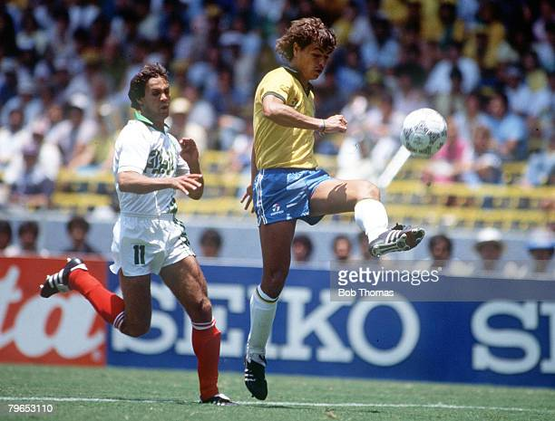 World Cup Finals Guadalajara Mexico 6th June Brazil 1 v Algeria 0 Brazil's Edinho clears the ball from Algeria's Rabah Madjer