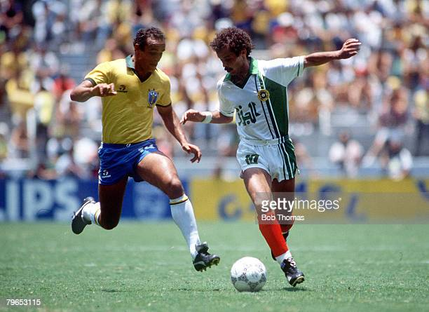 World Cup Finals Guadalajara Mexico 6th June Brazil 1 v Algeria 0 Brazil's Lakhdar Belloumi and Brazil's Elzo battle for the ball