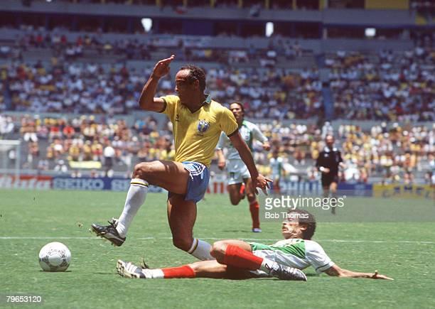 World Cup Finals Guadalajara Mexico 6th June Brazil 1 v Algeria 0 Brazil's Elzo beats Algeria's Lakhdar Belloumi
