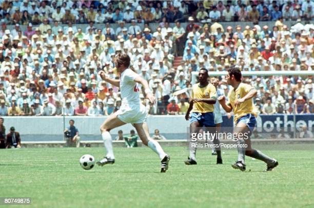 World Cup Finals Guadalajara Mexico 7th June England 0 v Brazil 1 England's Jeff Astle gets away from Brazilians Pele and Rivelino during the two...