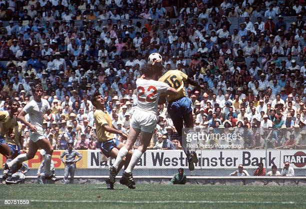 World Cup Finals Guadalajara Mexico 7th June England 0 v Brazil 1 England forward Jeff Astle jumps for the ball with Brazilian defender Everaldo as...