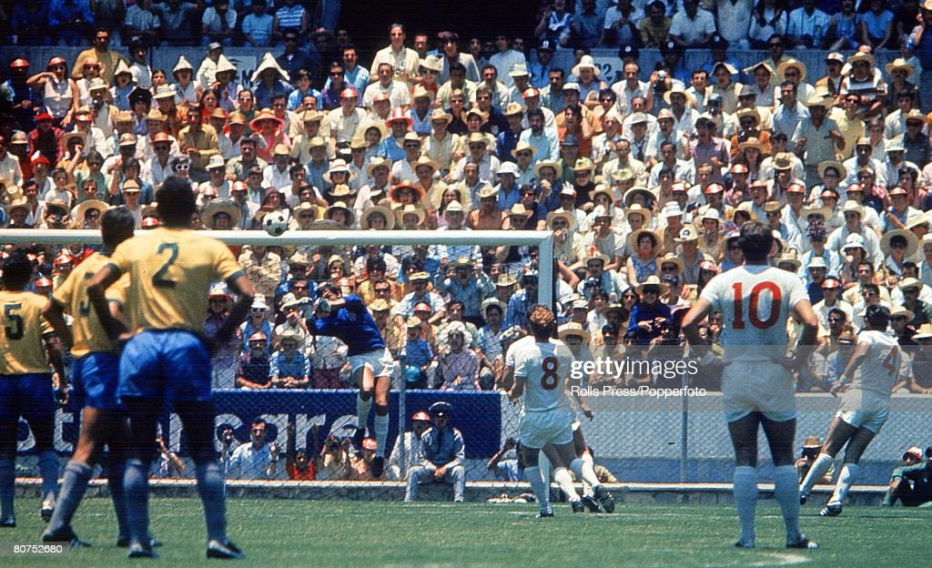 1970 World Cup Finals Guadalajara, Mexico 7th June, 1970. England 0 v Brazil 1. England goalkeeper Gordon Banks punches clear a Brazilian attack as his teammates Alan Ball (8) and Geoff Hurst (10) look on during the two teams' group Three match. : News Photo
