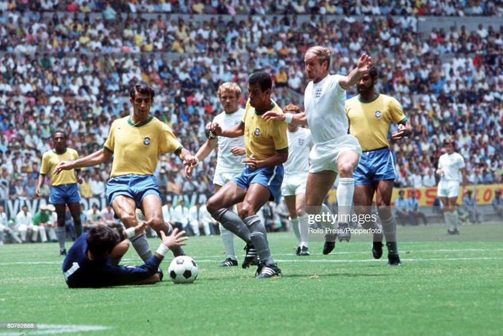 World Cup Finals, Guadalajara, Mexico 7th June, 1970, England 0 v Brazil 1, England's Bobby Charlton causes trouble for the Brazilian defence as goalkeeper Felix comes out to claim the ball