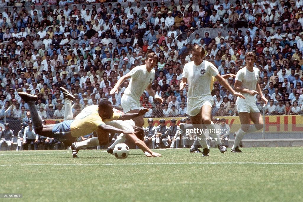 1970 World Cup Finals Guadalajara, Mexico 7th June, 1970. England 0 v Brazil 1. Brazilian forward Pele is brought down by England defender Alan Mullery as Martin Peters (3L) and Jeff Astle look on during the two teams' Group Three match. : News Photo