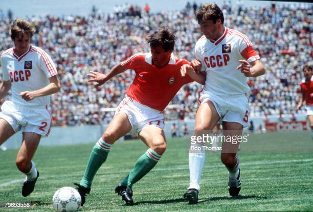 World Cup Finals Irapuato Mexico 2nd June USSR 6 v Hungary 0 Hungary's Bursca is challenged for the ball by USSR's Bessonov and Demianenko