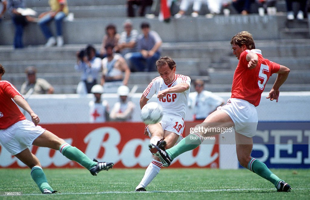 1986 World Cup Finals, Irapuato, Mexico, 2nd June, 1986, USSR 6 v Hungary 0, USSR's Igor Belanov clears the ball as Hungary's Josef Kardos tries to block : News Photo