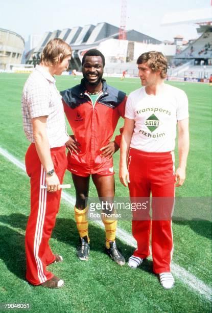 World Cup Finals La Coruna Spain 19th June Poland 0 v Cameroon 0 Cameroon's Roger Milla talks to Poland's Andre Szarmach and Marek Dziuba before the...